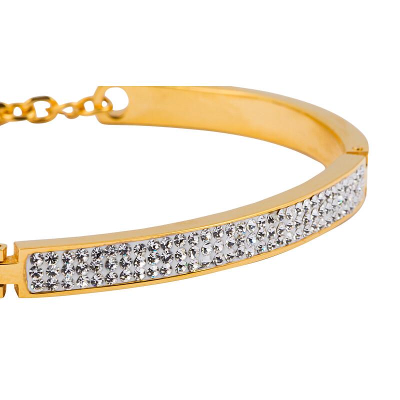 Goldfarbener Armreifen mit weißen Kristallen