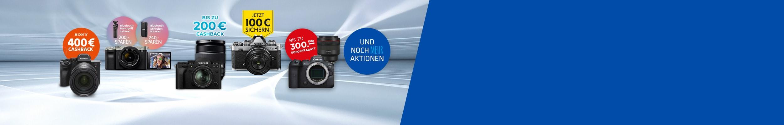 """""""vier Fotokameras von verschiedenen Marken in einer Reihe mit weiterem Equipment plus Infos zu Fotoaktionswochen"""""""