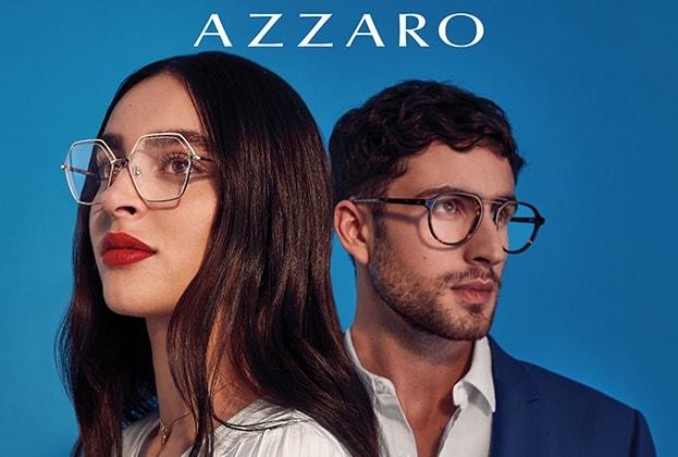 Pärchen vor blauem Hintergrund mit auffälligen Azzaro Brillen von Hartlauer