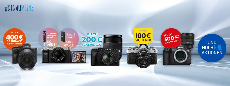 vier Fotokameras von verschiedenen Marken in einer Reihe mit weiterem Equipment plus Infos zu Fotoaktionswochen