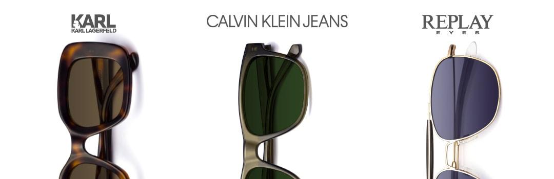drei Sonnenbrillen von Karl Lagerfeld, Calvin Klein Jeans und Replay Eyes mit Markenlogos auf weißem Hintergrund